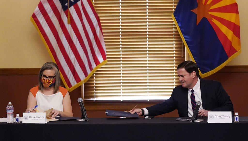 Arizona Secretary of State Katie Hobbs, left, and Arizona Gov. Doug Ducey sign election documents to certify the election results Nov. 30, 2020. (AP)