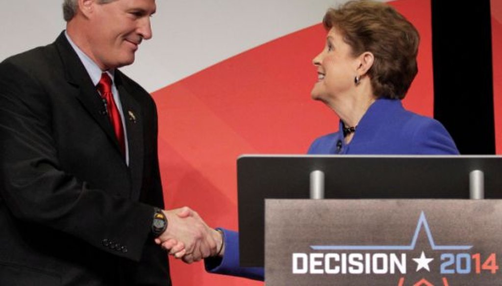 Republican Scott Brown and Democratic Sen. Jeanne Shaheen shake hands during a debate on Oct. 21, 2014.