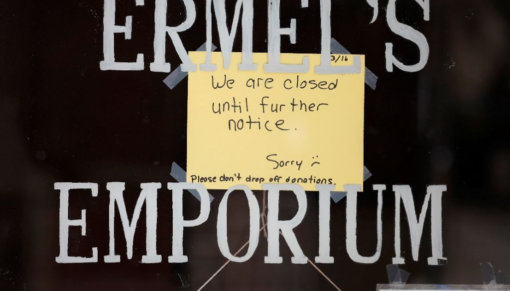 A sign hangs on the front door of a store shuttered store due to efforts to fend off coronavirus, in Central City, Colo., on March 17, 2020. (AP)