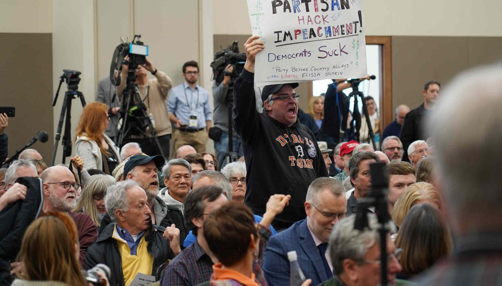 Larry Parsons, of Fenton, Mich., stands up and shouts as U.S. Rep. Elissa Slotkin speaks during a constituent forum on Dec. 16, 2019, in Rochester, Mich. (Ryan Garza, Detroit Free Press)
