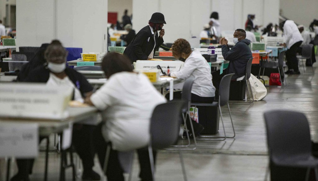 Detroit election workers count absentee ballots cast in the primary election on Aug. 4, 2020, at the TCF Center in Detroit. (Mandi Wright, Detroit Free Press)