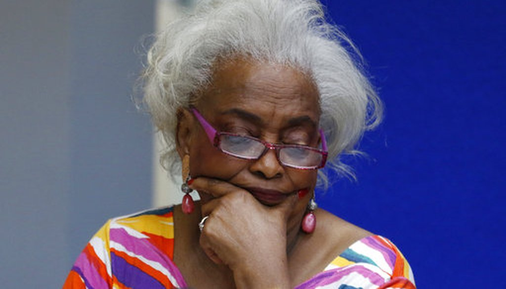 Brenda Snipes, Broward County Supervisor of Elections, looks at a ballot during a canvasing board meeting Friday, Nov. 9, 2018, in Lauderhill, Fla. (AP)