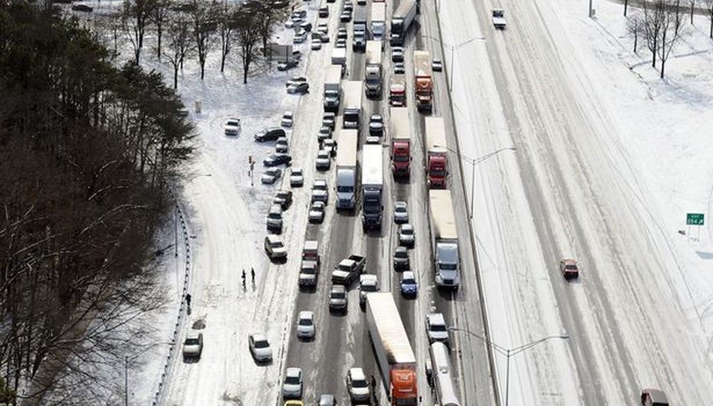 In this aerial view looking at I-75 north at Moores Mill Rd., some motorists leave their vehicles along the ice-covered interstate after a winter snow storm Wednesday, Jan. 29, 2014, in Atlanta. Photo credit: David Tulis/AP.