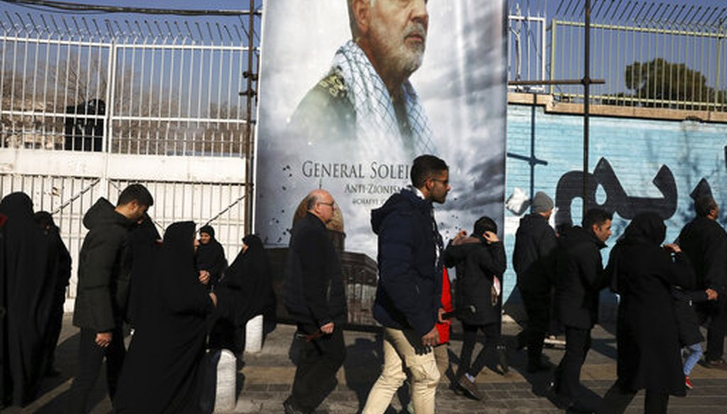 Mourners walk back from a funeral ceremony for Iranian Gen. Qassem Soleimani in front of the former U.S. Embassy, in Tehran. (AP Photo/Vahid Salemi)