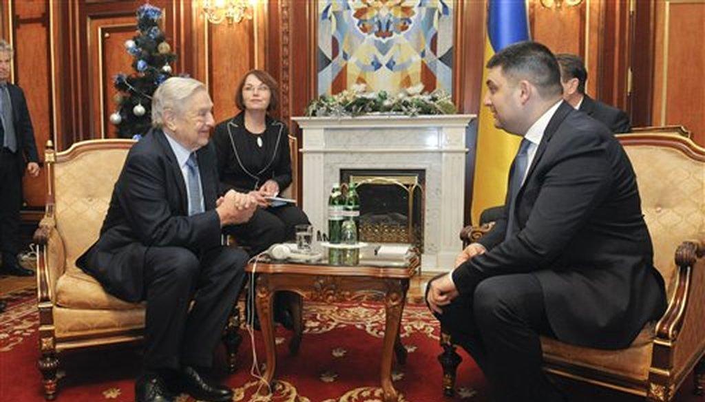 George Soros, left, chairman of Soros Fund Management and founder of The Open Society Institute, speaks with Volodymyr Groysman, Ukrainian parliament speaker in Kiev, Ukraine, Monday, Jan. 12, 2015. (AP)