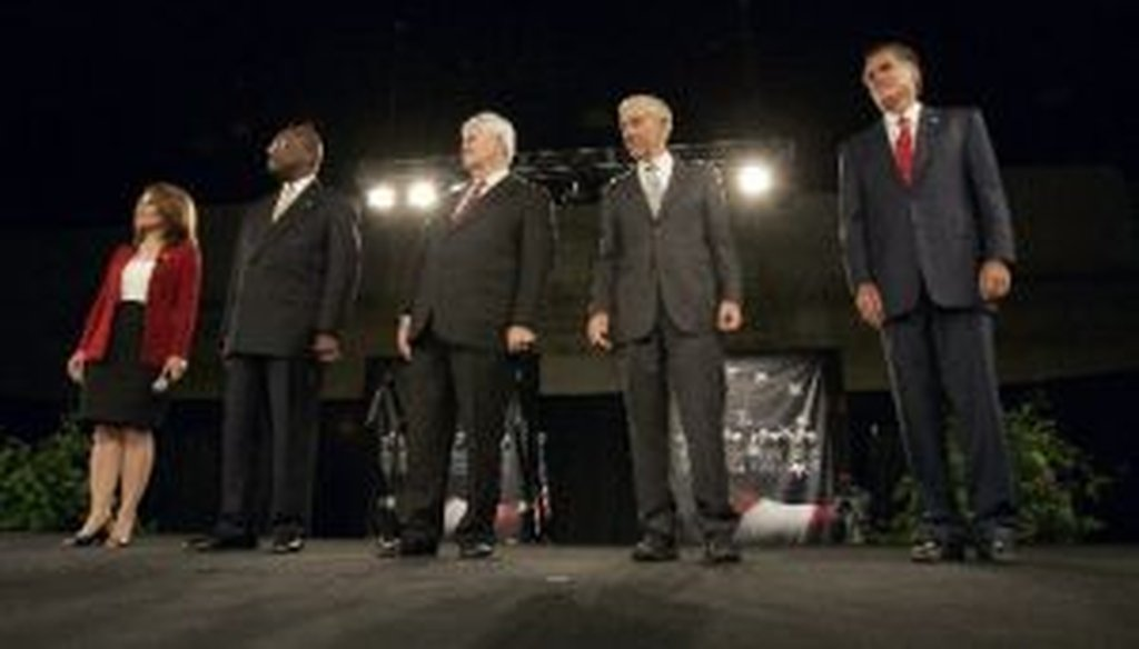 Republican presidential candidates Michele Bachmann, Herman Cain, Newt Gingrich, Ron Paul and Mitt Romney pose before the American Principles Project Palmetto Freedom Forum Monday, Sept. 5, 2011, in Columbia, S.C.