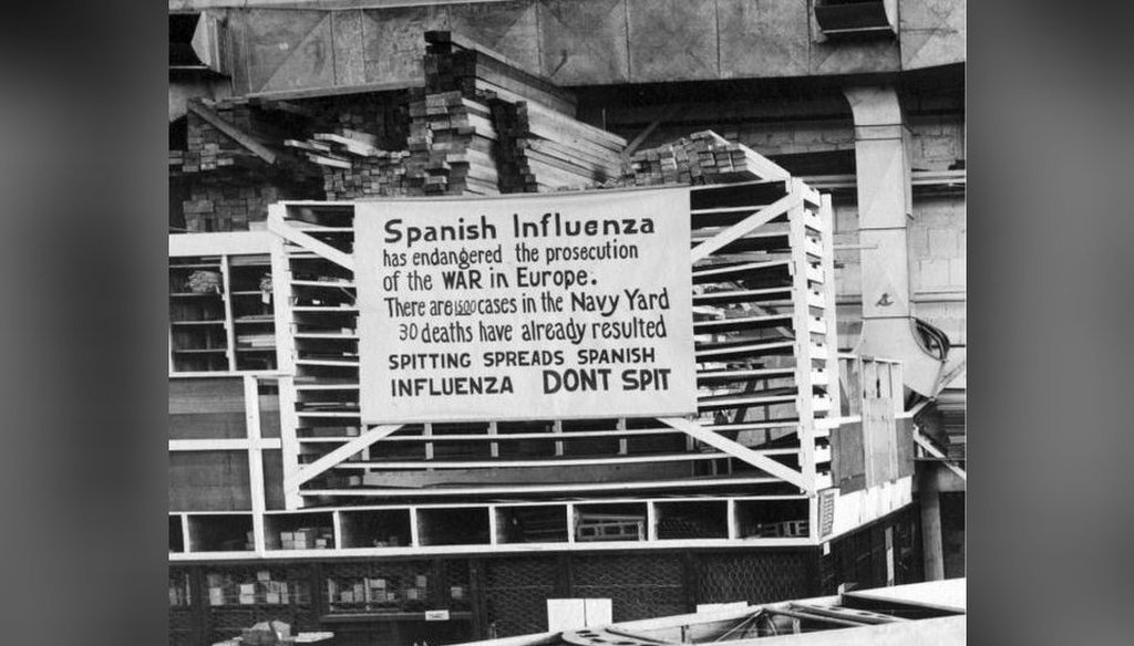 In this Oct. 19, 1918, photo provided by the U.S. Naval History and Heritage Command, a sign is posted at the Naval Aircraft Factory in Philadelphia that indicates what was called the Spanish flu was then extremely active. (AP)