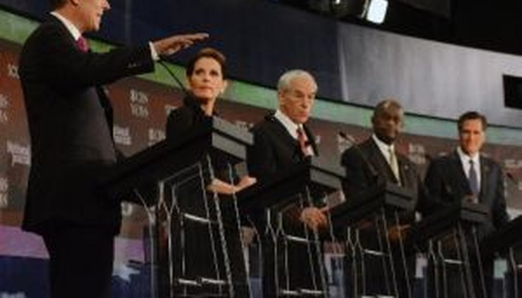 Republican presidential candidates Jon Huntsman, Michele Bachmann, Ron Paul, Herman Cain, and Mitt Romney, listen during the CBS News/National Journal foreign policy debate on Saturday, Nov. 12, 2011, in Spartanburg, S.C.