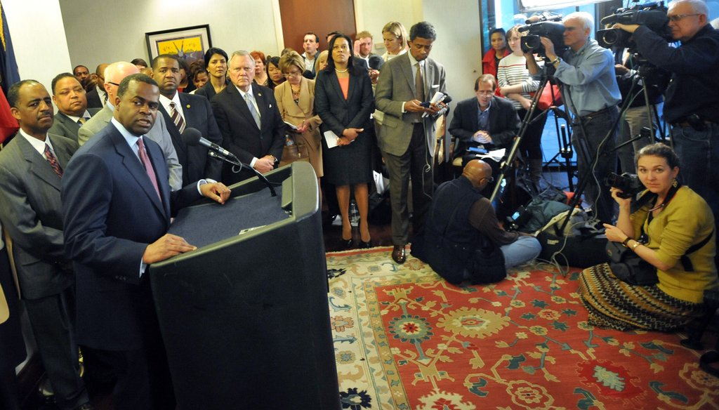 Atlanta Mayor Kasim Reed, standing at the microphone, takes a question from a reporter during a March 7, 2013 press conference to announce a deal with the Atlanta Falcons on a $1 billion stadium.