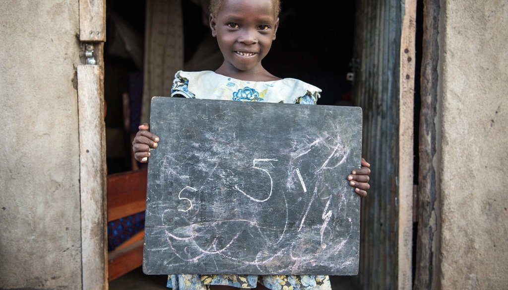 Susan Andua, 5, outside her mother Florence's house in Nimule, South Sudan.(UNICEF/UNI203956/Everett)