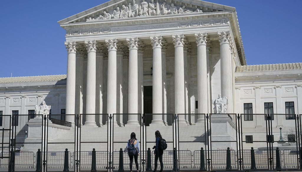 Security fencing surrounds the Supreme Court building on Capitol Hill in Washington, Sunday, March 21, 2021. (AP Image)