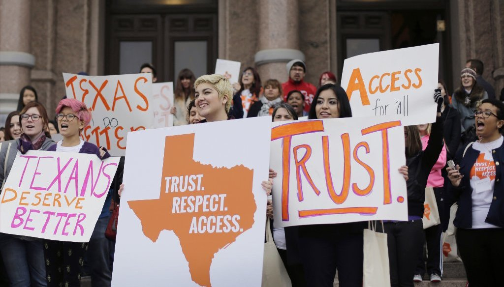 Protesters outside the Texas state house in 2015 voiced their disapproval of abortion restrictions that critics predicted would drive more women to risk self-abortions. (AP Photo).