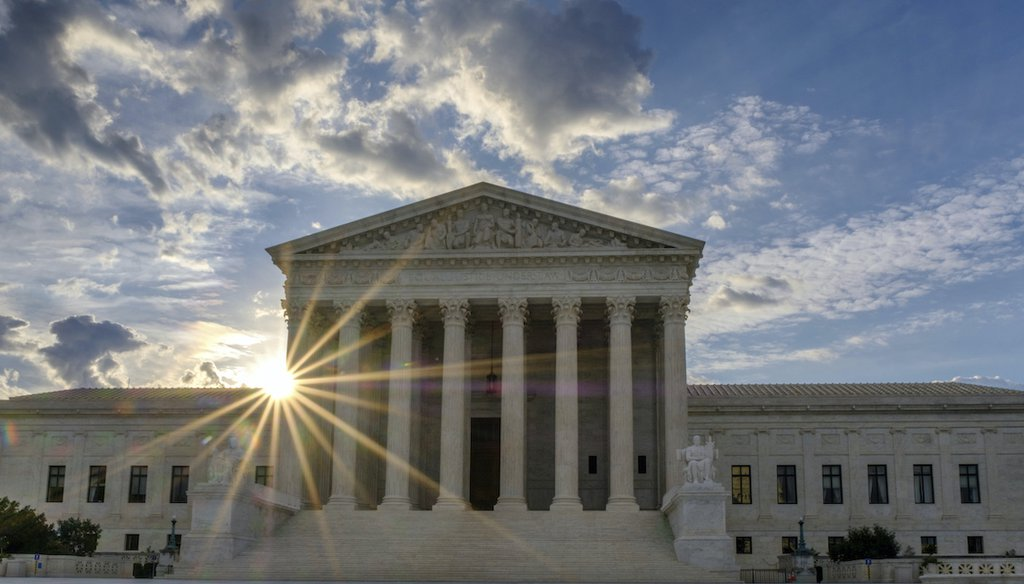 The sun flares in the camera lens as it rises behind the U.S. Supreme Court building in Washington, Sunday, June 25, 2017. (AP)