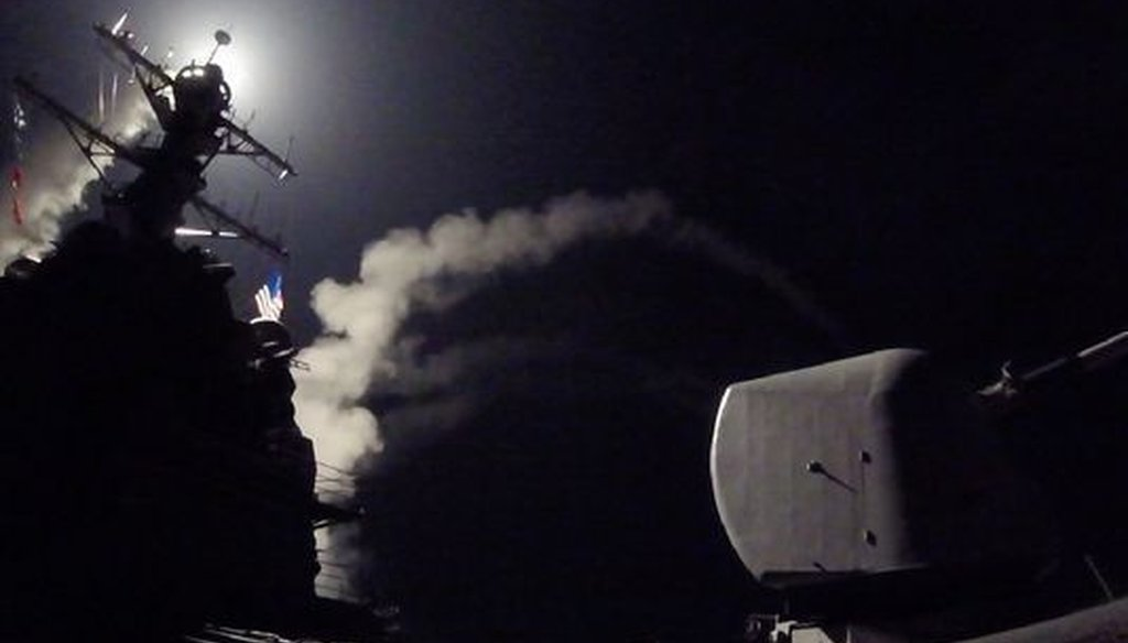 The guided-missile destroyer USS Porter (DDG 78) fires a tomahawk land attack missile from the Mediterranean Sea at a Syrian air base on April 6, 2017. (Photo by Communication Specialist 3rd Class Ford Williams, U.S. Navy, via Associated Press)