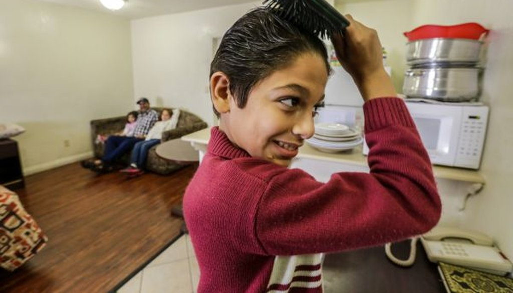 Eleven-year-old Omran Wawieh, a refugee from Syria, is staying with parents and siblings at a motel in Pomona, Calif., on Nov. 17, 2015. (Irfan Khan/Los Angeles Times/TNS)