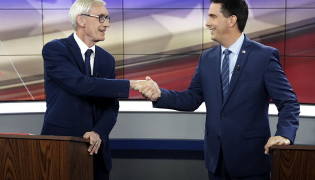 Democratic challenger Tony Evers (left) and Gov. Scott Walker, a Republican, shake hands before the start of their gubernatorial debate hosted by the Wisconsin Broadcasters Association Foundation Oct. 19, 2018, in Madison. (Associated Press)