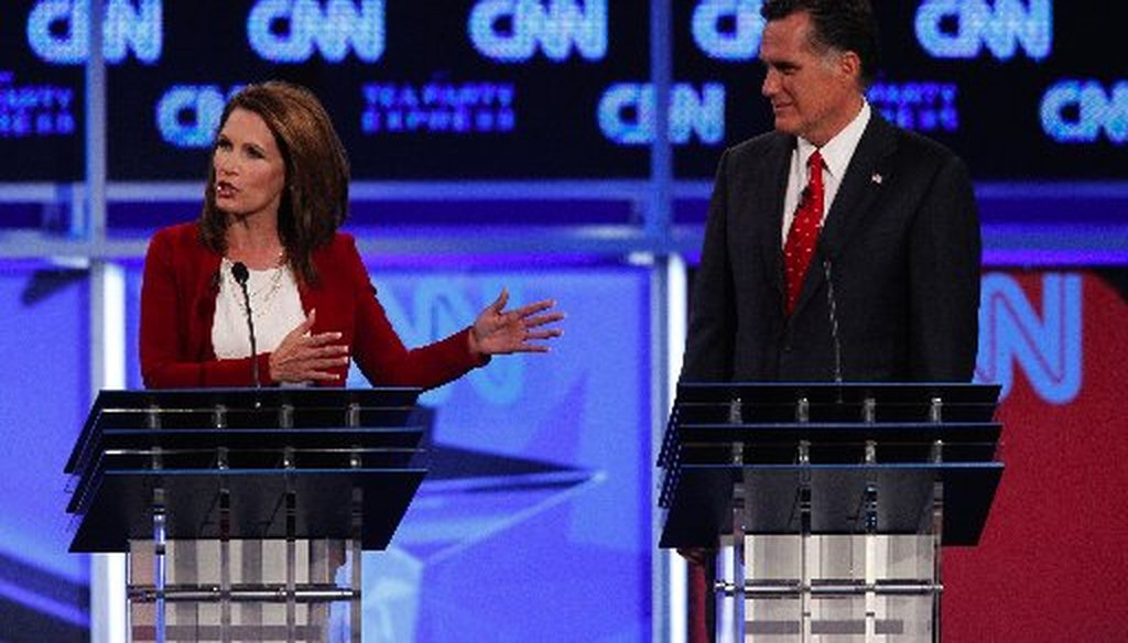 Rep. Michele Bachmann and Mitt Romney at Monday's CNN/Tea Party Express debate in Tampa.
