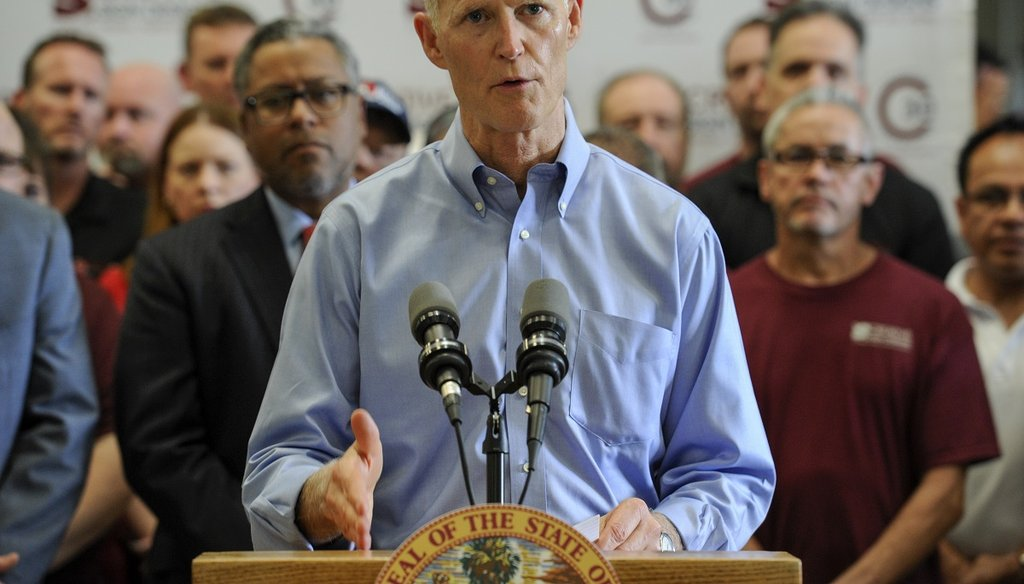 Florida Governor Rick Scott speaks at Creative Sign Designs June 13, 2017, in Tampa. (CHRIS URSO | Times)
