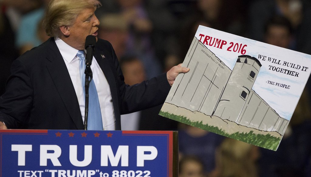 Donald Trump holds a sign from a supporter during a rally Wednesday, March 9, 2016 at the Crown Coliseum in Fayetteville, N.C. (via The News & Observer)