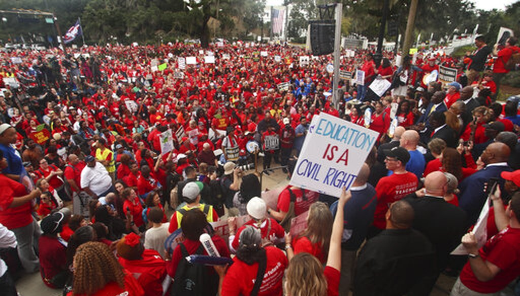 "Teachers and supporters march Monday, Jan. 13, 2020, during the Florida Education Association's ""Take on Tallahassee"" rally at the Old Capitol in Tallahassee, Fla. (AP)"