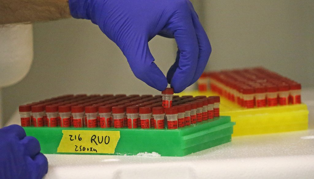 A lab technician prepares components for COVID-19 testing kits in Salt Lake City. (AP Photo/Rick Bowmer)
