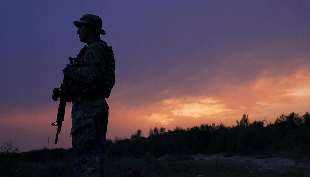 A member of the Texas Military Department stands guard along the U.S.-Mexico border Tuesday, May 11, 2021, in Roma, Texas.