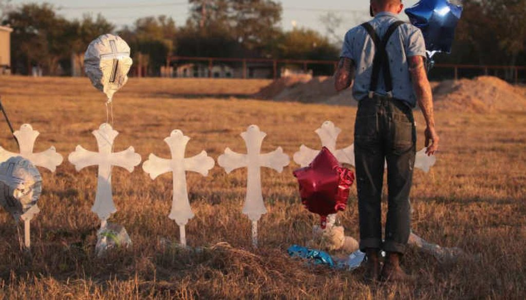 Derrick Bernaden of San Antonio, Texas visits a memorial where 26 crosses stand in a field on the edge of town to honor the 26 victims killed at the First Baptist Church of Sutherland Springs. (Getty Images)