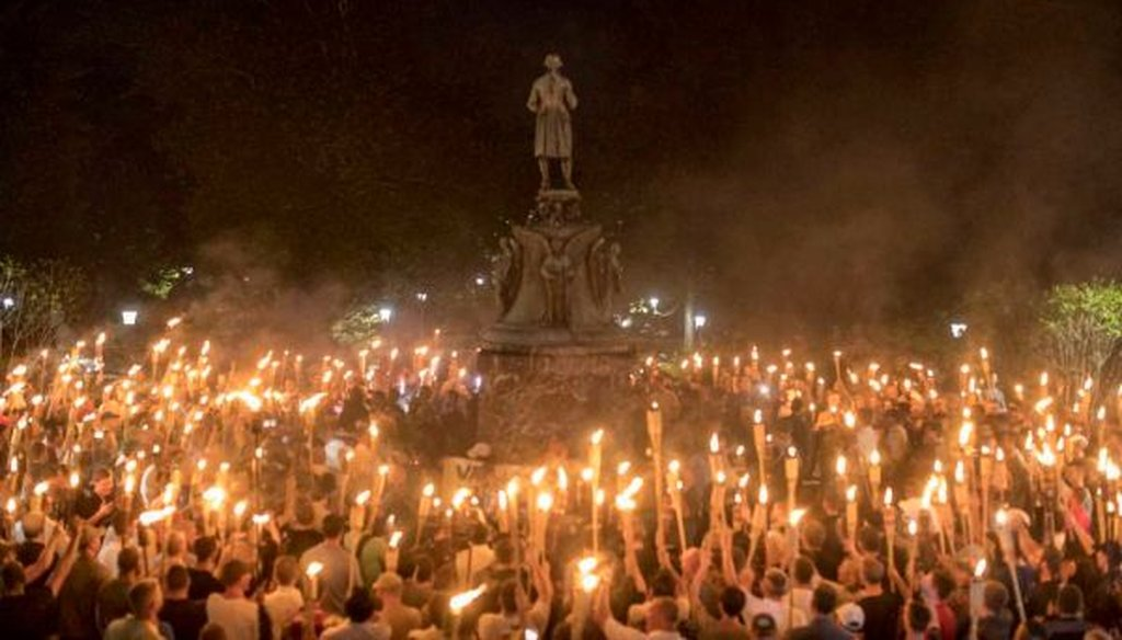 Torch-bearing white nationalists rally around a statue of Thomas Jefferson on the University of Virginia campus in Charlottesville, Va., on Aug. 11, 2017. (Edu Bayer/New York Times)
