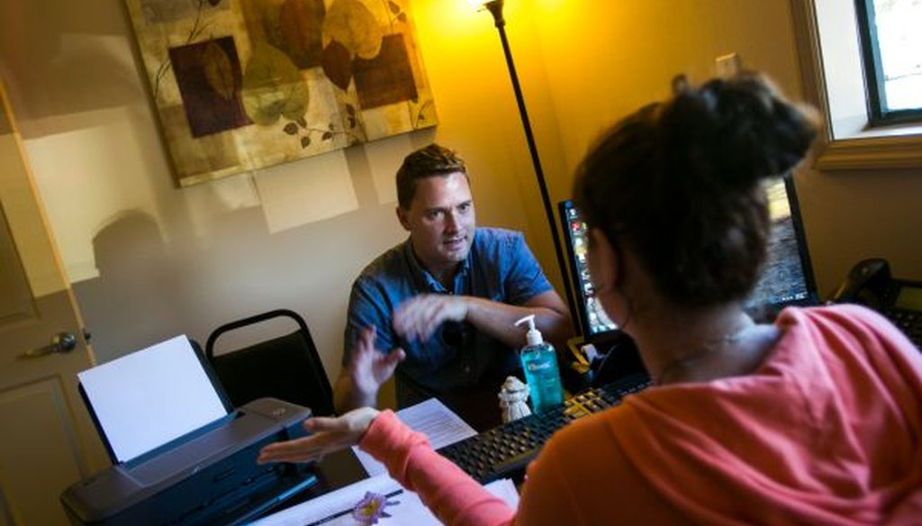 Brian Donnelly, 30, talks with admissions manager Annie Digirolamo during his pre-intake session at a new drug treatment clinic in Spring Hill, Fla., on Oct. 1, 2013. (Will Vragovic/Tampa Bay Times)