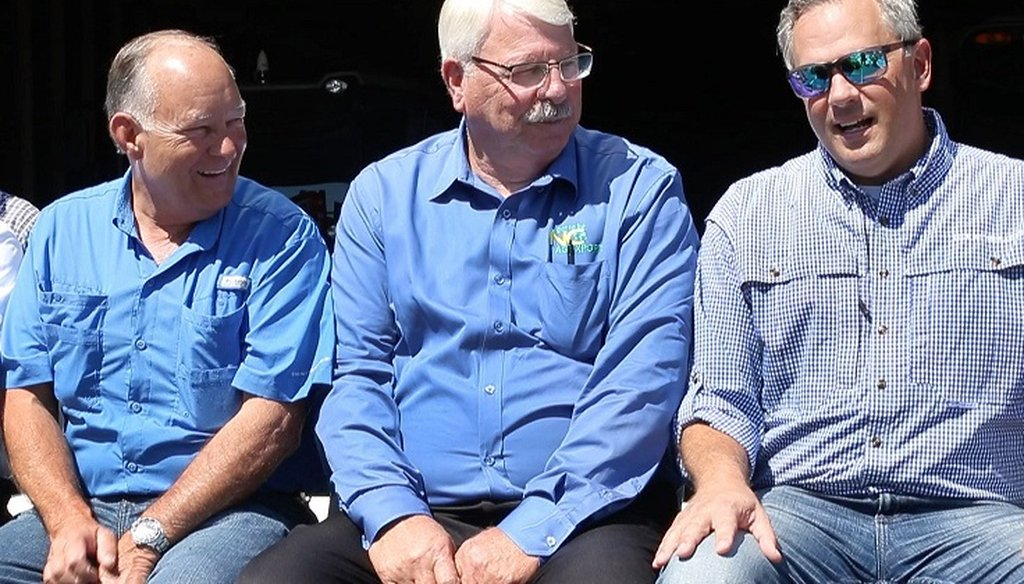 From left, state Senator Bret Jackson and Commissioner of Agriculture Steve Troxler chat with Lt. Gov. Dan Forest during a rally with farmers on Tuesday, July 10, 2018 at Joey Carter's farm in Duplin County near Beulaville, N.C.