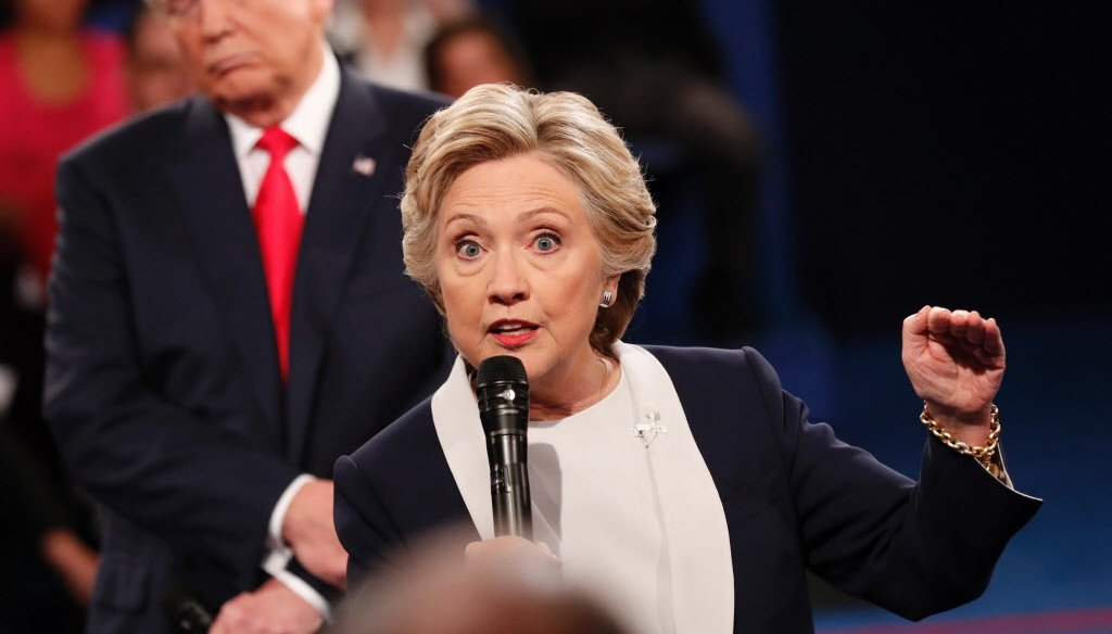 Democratic presidential nominee Hillary Clinton, front, and Republican nominee Donald Trump participate in a town hall debate at Washington University in St. Louis, Missouri, in Octover 2016. (Getty)