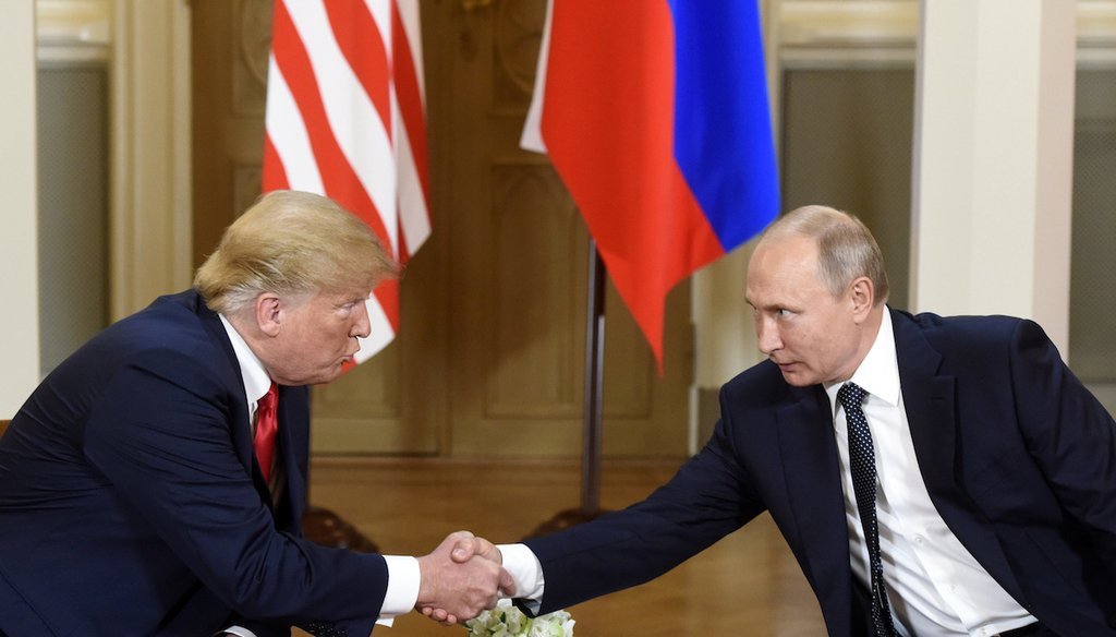 U.S. President Donald Trump and Russian President Vladimir Putin shake hands during their meeting in the Presidential Palace in Helsinki on July 16, 2018. (AP)