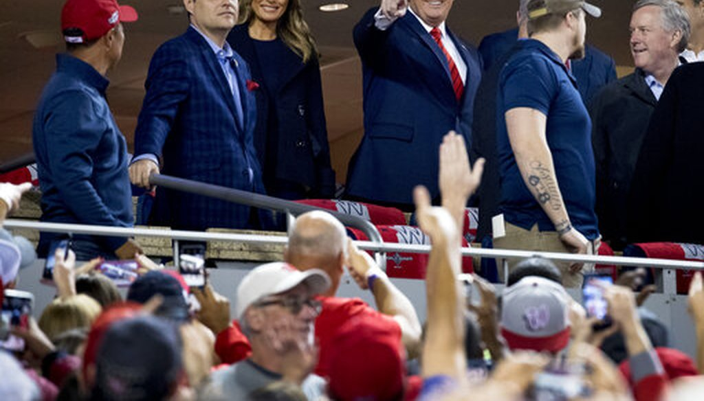 President Donald Trump and first lady Melania Trump, third from left, arrive for Game 5 of the World Series baseball game between the Houston Astros and the Washington Nationals at Nationals Park in Washington, Sunday, Oct. 27, 2019. (AP)
