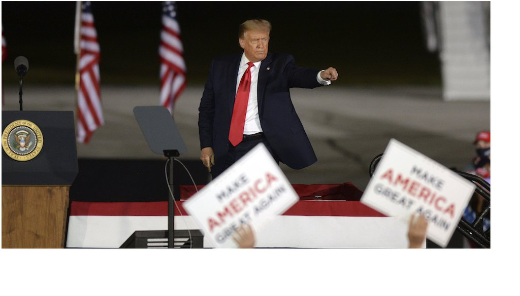 President Donald Trump acknowledges a supporter following a campaign rally at MBS International Airport  in Freeland, Mich. (AP Photo/Jose Juarez)