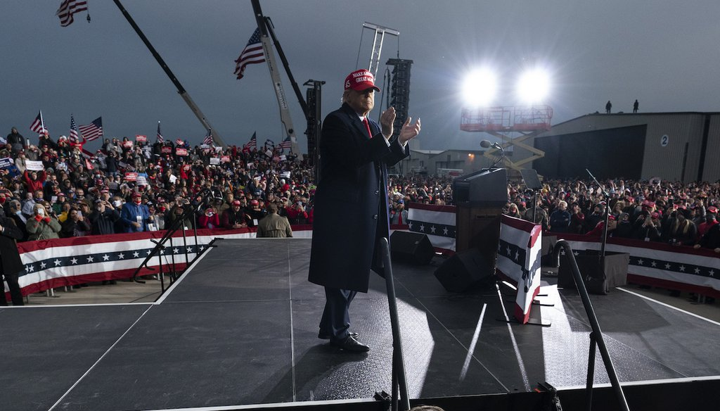 President Donald Trump at the finish of a campaign rally at Muskegon County Airport in Michigan. (AP Photo/Alex Brandon)