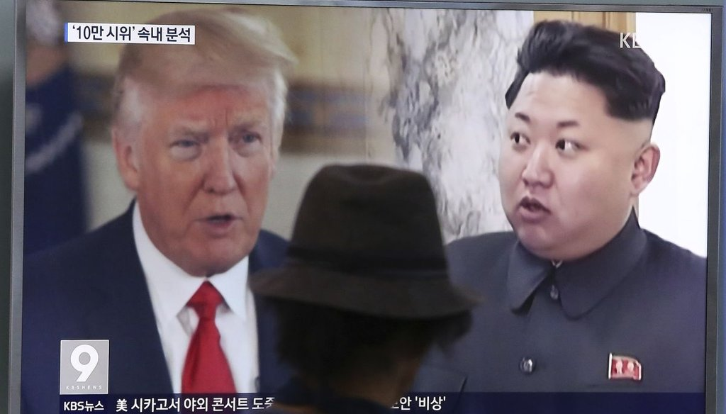 A South Korean channel broadcasts images of President Donald Trump and Kim Jong Un.