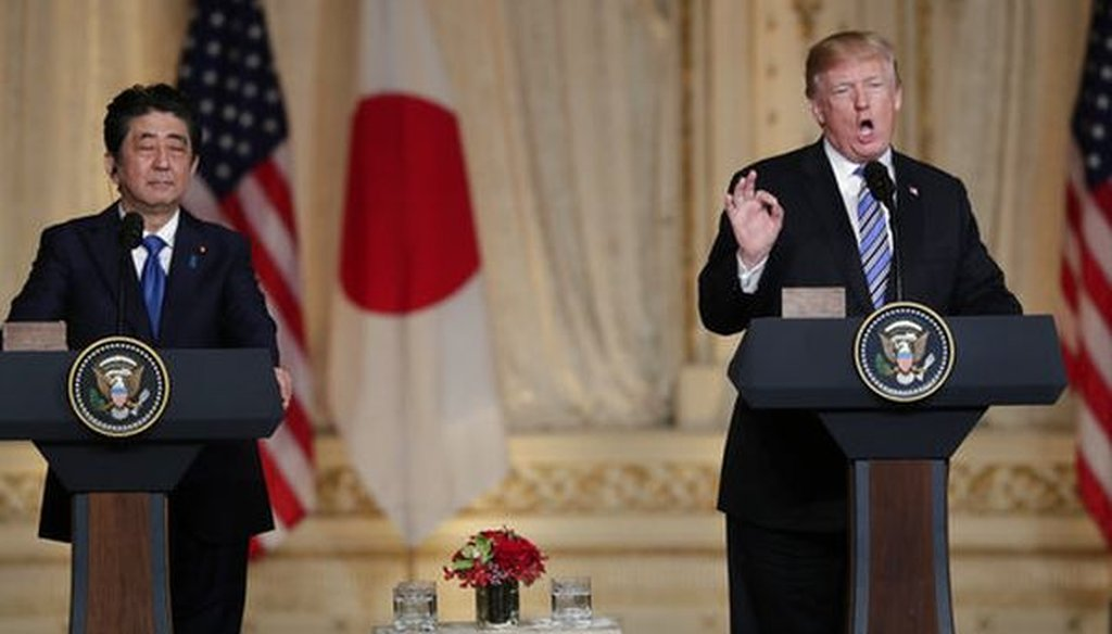 Japanese Prime Minister Shinzo Abe, left, listens as President Donald Trump, right, speaks during a news conference at Trump's Mar-a-Lago club on April 18, 2018. (AP/Lynne Sladky)