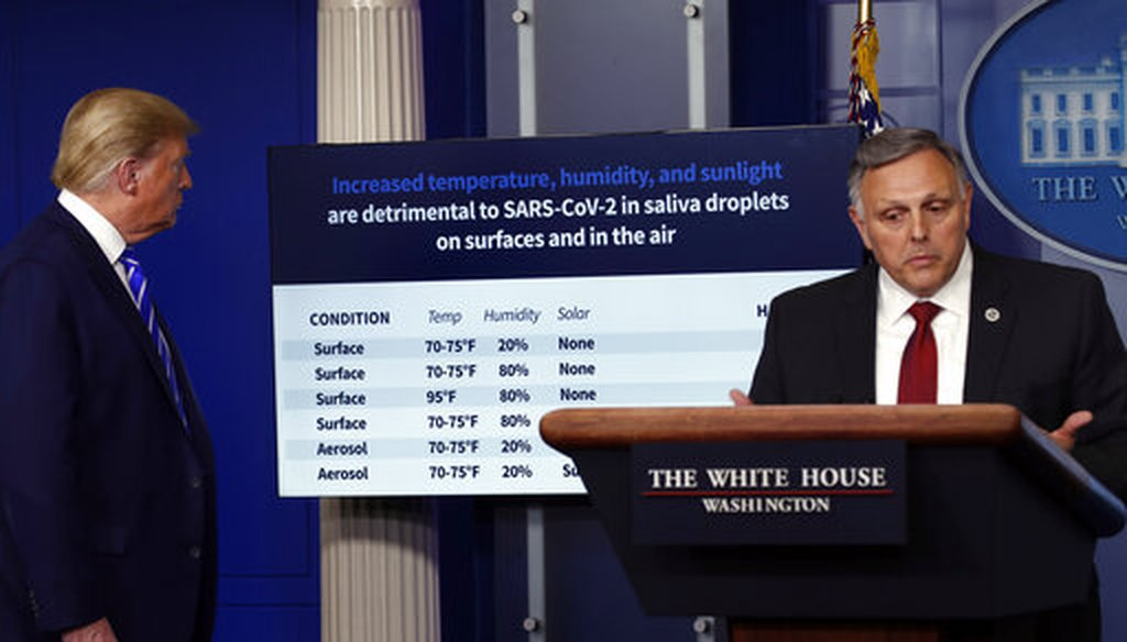 President Donald Trump looks at a chart as Bill Bryan, head of science and technology at the Department of Homeland Security, speaks about the coronavirus in the James Brady Press Briefing Room of the White House, April 23, 2020. (AP)