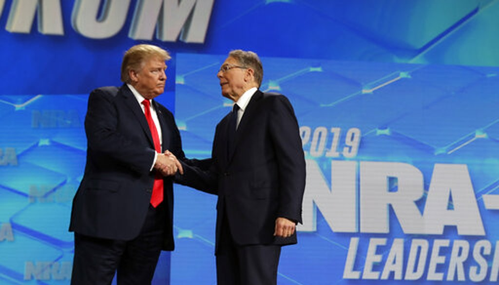 President Donald Trump shakes hands with NRA executive vice president and CEO Wayne LaPierre, has he arrives to speak to the annual meeting of the National Rifle Association, Friday, April 26, 2019, in Indianapolis. (AP)