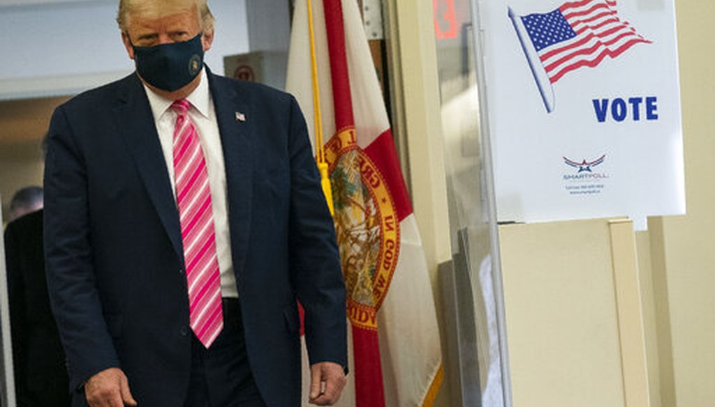 President Donald Trump walks to speak with reporters after voting at the Palm Beach County Main Library, Saturday, Oct. 24, 2020, in West Palm Beach, Fla. (AP)