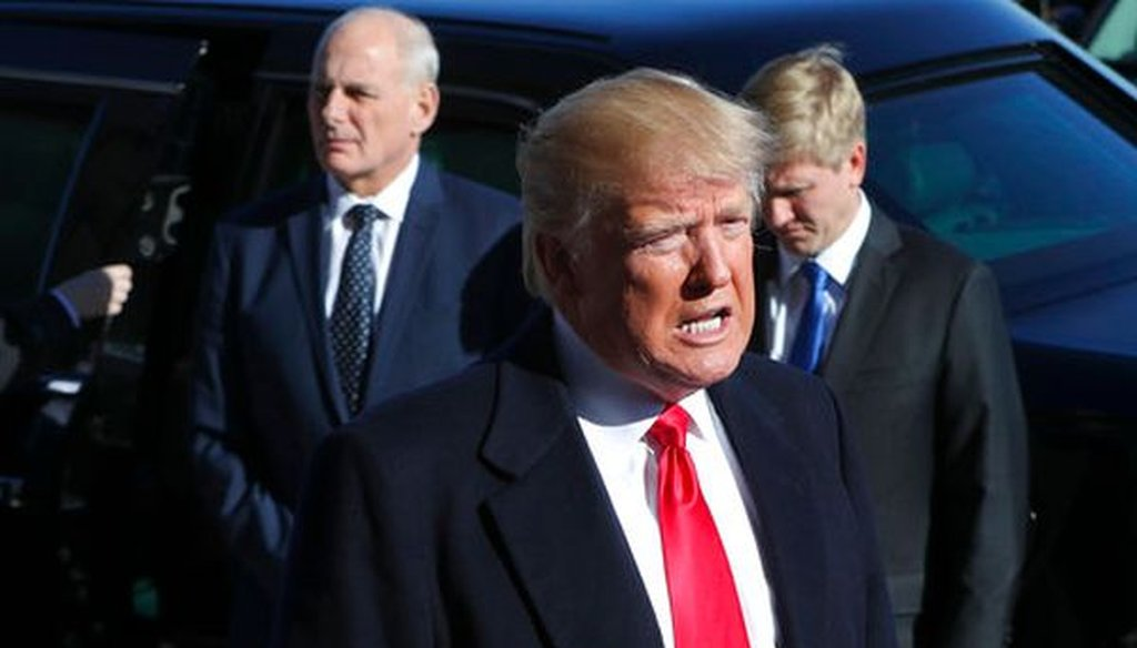 President Donald Trump makes remarks while arriving at the Pentagon on Jan. 18, 2018. Standing behind him is White House Chief of Staff John Kelly. (AP/Pablo Martinez Monsivais)