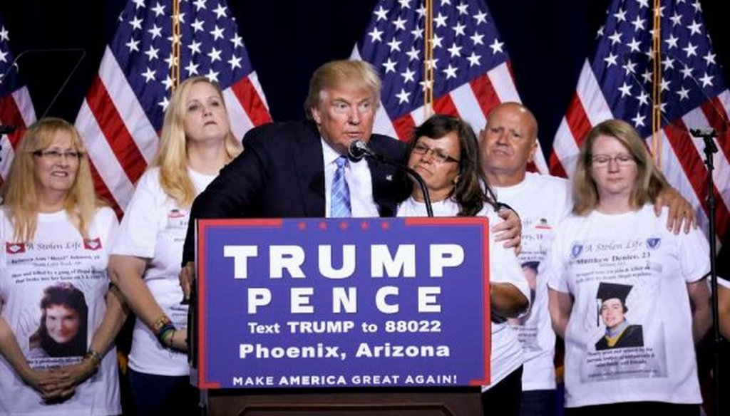 "Donald Trump with ""Angel Moms,"" parents who say their children were killed by illegal immigrants, during a campaign event focused on immigration policy in Phoenix on Aug. 31, 2016. (Travis Dove/The New York Times)"