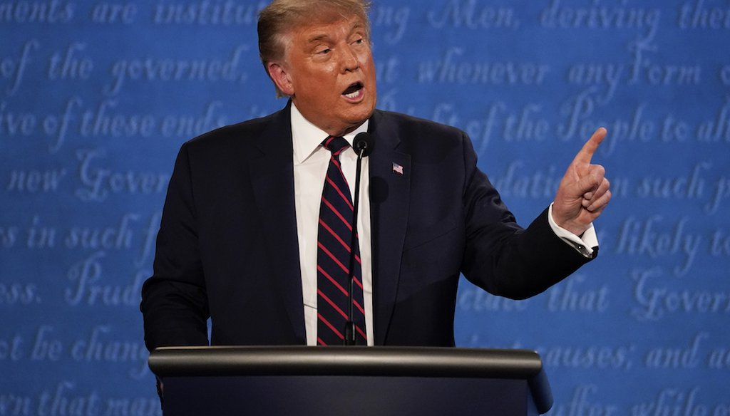 President Donald Trump gestures while speaking during the first presidential debate in Cleveland, Ohio. (AP Photo/Julio Cortez)