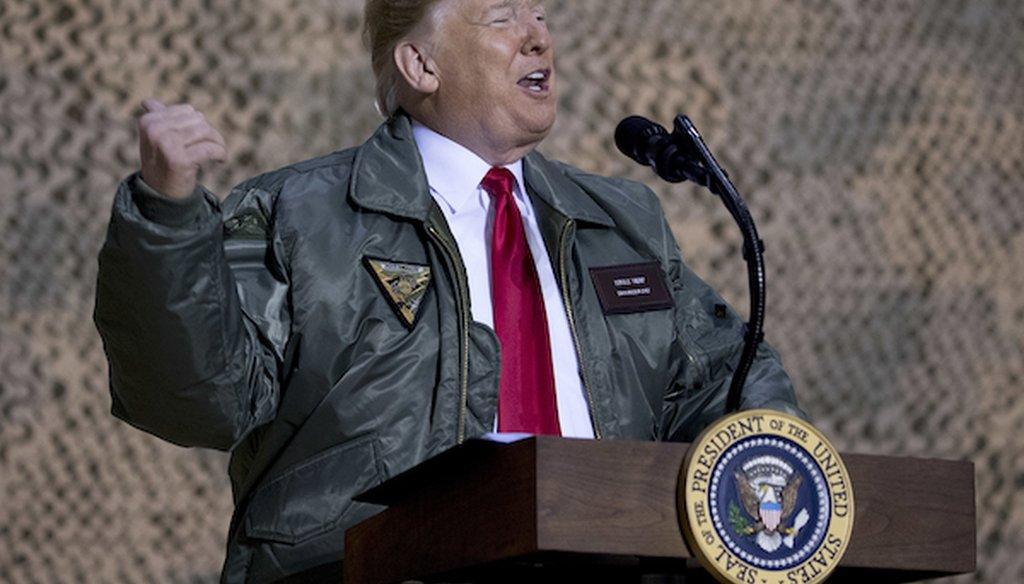 President Donald Trump speaks at a hangar rally at Al Asad Air Base, Iraq, Wednesday, Dec. 26, 2018. (AP)