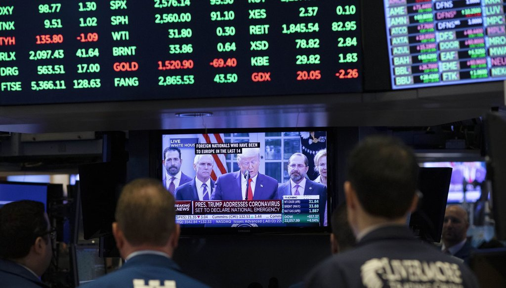 Traders listen at the New York Stock Exchange to President Donald Trump's televised remarks from the White House, March 13, 2020, in New York. (AP )
