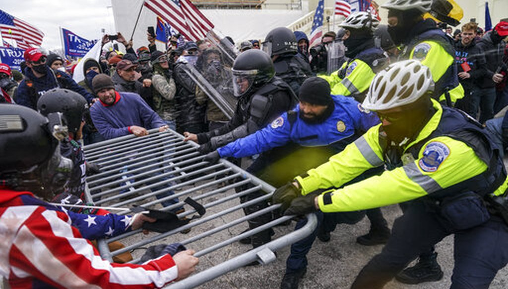 Trump supporters try to break through a police barrier, Wednesday, Jan. 6, 2021, at the Capitol in Washington. (AP)