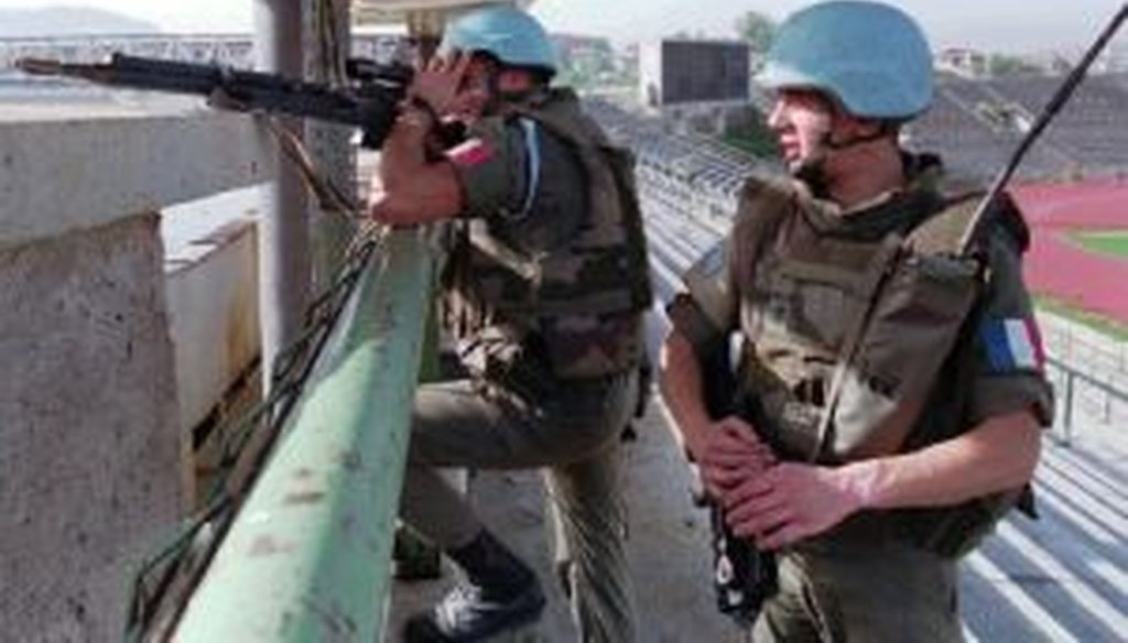 Two French peacekeepers from an anti-sniper unit take positions in Sarajevo's Olympic stadium on Sept. 27, 1994, attempting to suppress sniper fire in and around the war-torn capital of Bosnia-Herzegovina.