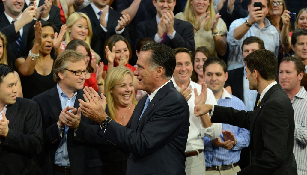 Republican Party president nominee Mitt Romney and his running mate Paul Ryan greet supporters at the party's convention in Tampa.