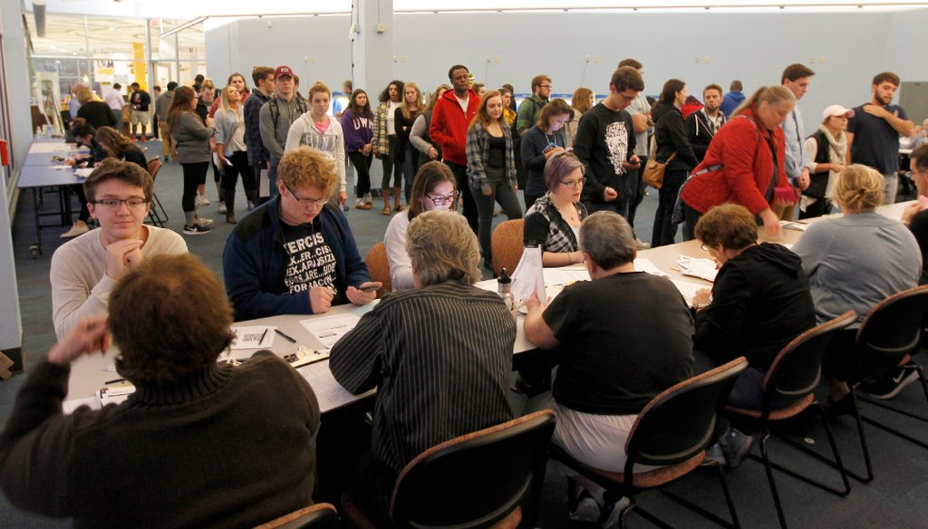 Students at the University of Wisconsin-Milwaukee register to vote on Nov. 8, 2016 before casting ballots in the presidential election. (Pat A. Robinson/Milwaukee Journal Sentinel)