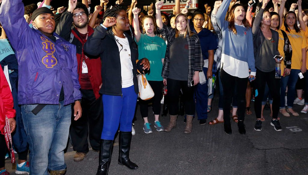 University of Oklahoma students gather outside the now closed University of Oklahoma's Sigma Alpha Epsilon fraternity house during a rally in reaction to members of the fraternity captured on video chanting a racial slur. (AP)